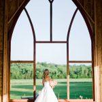 Jenni in front of chapel windows