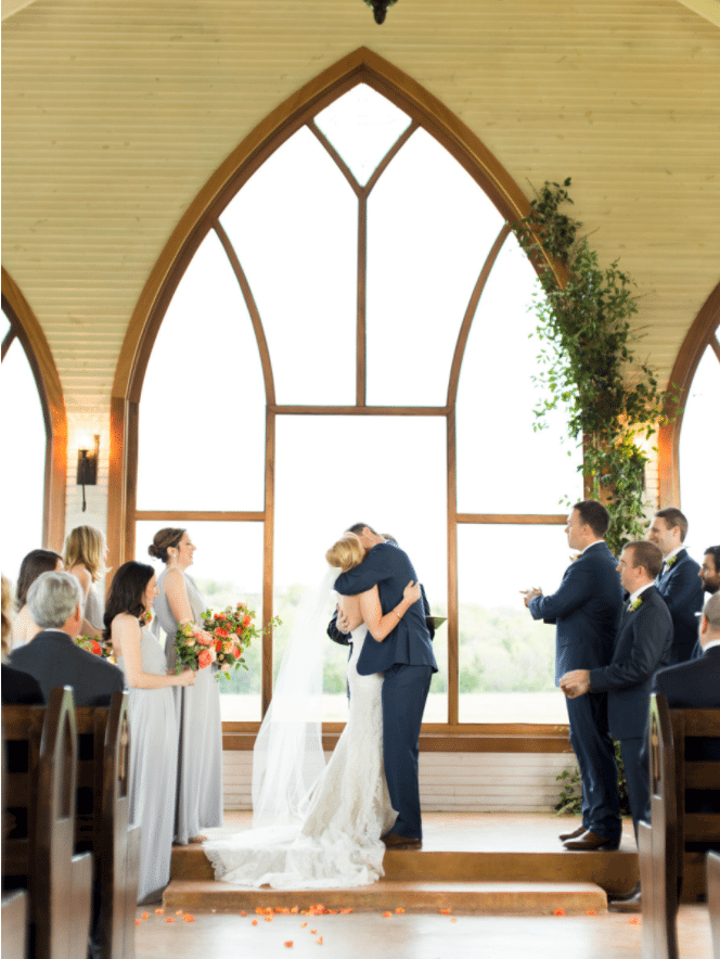 chapel greenery, altar, kiss the bride